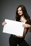 Brunette holding blank sign. Stock Photos