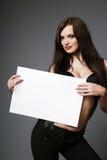 Brunette holding blank sign. stock photos