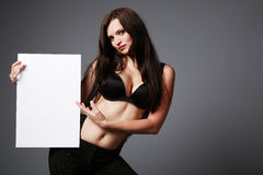 Brunette holding blank sign. Stock Image