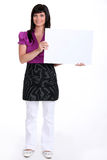 Brunette holding a canvas Royalty Free Stock Image