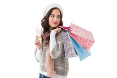 Brunette holding cash and shopping bags Stock Photos