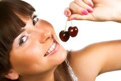 Brunette holding cherries Stock Photography