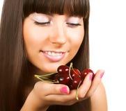 Brunette holding cherries Stock Image