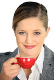 Brunette holding coffee Royalty Free Stock Photography