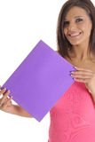 Brunette holding copyspace. Shot of a brunette holding copyspace Royalty Free Stock Images