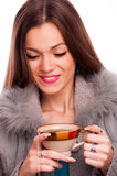 Brunette holding cup of tea Stock Photo