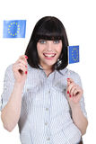 Brunette holding European flags Royalty Free Stock Images