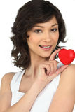 Brunette holding a foam heart Stock Photography