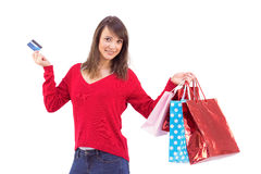 Brunette holding gift and credit card Stock Image