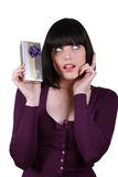 Brunette holding gift Royalty Free Stock Image