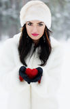 Brunette holding red heart Royalty Free Stock Images