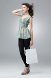 Brunette holding shopping bag Stock Image