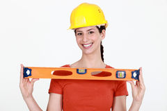 Brunette holding spirit-level Royalty Free Stock Photography
