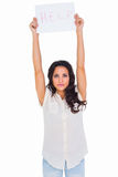 Brunette holding up help sign Royalty Free Stock Photo