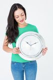 Brunette holding wall clock Stock Images