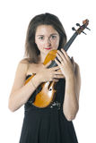 Brunette holds violin in studio against white background Royalty Free Stock Image
