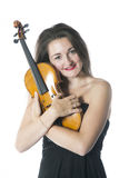 Brunette holds violin in studio against white background Stock Image