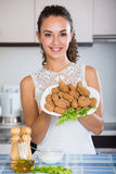 Brunette with home-made croquettes Stock Photography