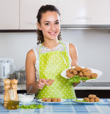 Brunette with home-made croquettes Royalty Free Stock Images