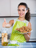 Brunette with home-made croquettes Royalty Free Stock Photo