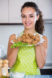 Brunette with home-made croquettes Royalty Free Stock Image