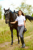 Brunette with horse Stock Photos