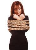 Brunette hostage, captive woman bound with rope Stock Photography