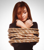 Brunette hostage, captive woman bound with rope Royalty Free Stock Photo
