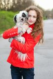 Brunette hugging little dog Royalty Free Stock Photo