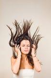 Brunette immersed in music wearing headphones. Royalty Free Stock Image