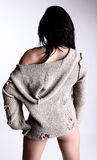 Brunette In A Knitted Jacket Standing Back Stock Photo