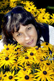 Brunette In Yellow Flowers Stock Images