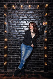 Brunette in jacket and jeans Royalty Free Stock Image