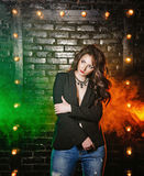Brunette in jacket and jeans Royalty Free Stock Images