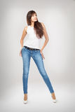 Brunette in jeans Royalty Free Stock Photography
