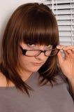 Brunette joven en vidrios Imagen de archivo