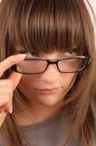 Brunette joven en vidrios Imágenes de archivo libres de regalías