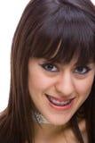Brunette joven hermoso con los corchetes en los dientes 2 Imagen de archivo libre de regalías