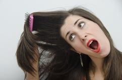 Brunette joven streesed para la vanidad Foto de archivo libre de regalías