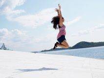 Brunette jumping of joy Stock Images