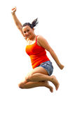 Brunette jumping on trampoline Royalty Free Stock Images