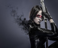 Brunette with katana sword, fineart concept Royalty Free Stock Image