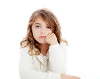 Brunette kid girl portrait on white desk table royalty free stock photos