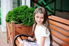 Brunette kid girl at shopping center Royalty Free Stock Photography