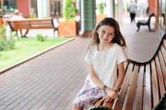 Brunette kid girl at shopping center Royalty Free Stock Image