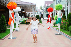 Brunette kid girl walking around shopping center Stock Image