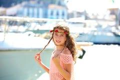 Brunette kid teen girl in Mediterranean port Spain Royalty Free Stock Image