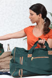 Brunette with kit bag Stock Photos