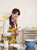 Brunette Kneading a Ball of Dough Stock Images