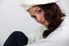 Brunette in knitted cream jumper Royalty Free Stock Images